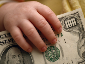 michael-melford-young-child-s-hand-holding-a-100-bill